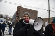 Anthony Clark, of Oak Park, talks to the crowd talking to demonstrators hold up signs in protest last Saturday, Jan. 12, during a Mute R. Kelly protest outside of his studio on Justine Street in Chicago. | ALEXA ROGALS/Staff Photographer