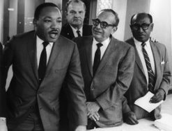 A LIFE IN STRUGGLE: Timuel Black, far left, with Dr. Martin Luther King Jr., circa 1965. Below, the covers of two of Black's many books. | Photo provided by Chicago Public Library