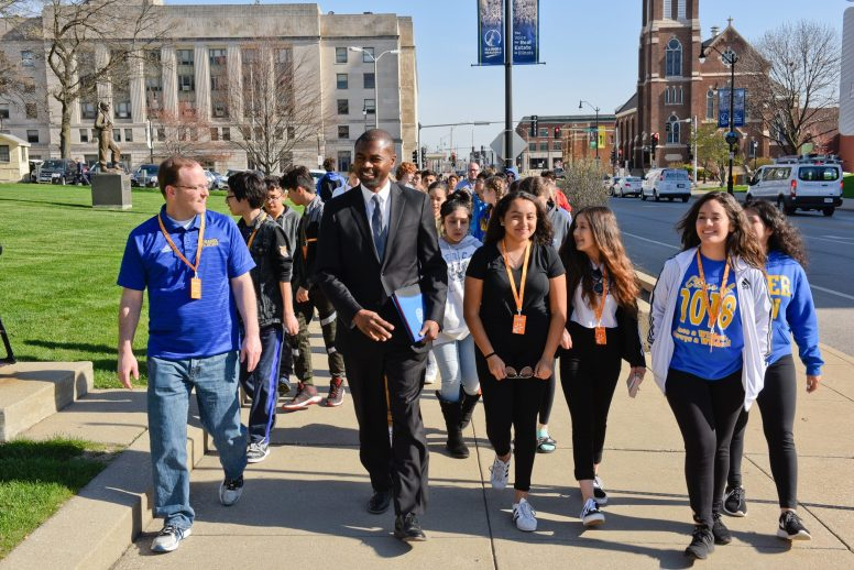 THE AUSTIN CANDIDATE: State Rep. La Shawn K. Ford, shown walking with young people in Springfield last year, said that he's struggled for recognition being the sole Austin resident in the crowded race for mayor of Chicago. | File photo