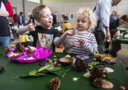 Ellis Strupp, 5, of Brookfield, and Eiley McPeak, 2, of Glen Ellyn, play with fake bugs on Saturday, March 2, during the Juicebox Concert series at the Garfield Park Conservatory. | ALEXA ROGALS/Staff Photographer