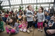 Leaps of fun: Children dance as the Little Miss Ann Band plays music on Saturday, March 2, during the Juicebox Concert series at the Garfield Park Conservatory. | ALEXA ROGALS/Staff Photographer