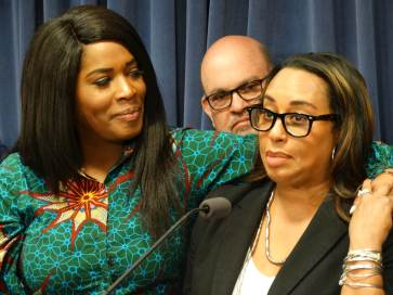 SWEET MOMENT: Rep. Jehan Gordon-Booth (left) and Sen. Toi Hutchinson, key sponsors in their respective chambers of a bill to legalize recreational marijuana in Illinois, speak at a news conference May 30 at the Capitol in Springfield. | Photo by Peter Hancock/Capitol News Illinois