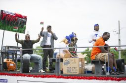 Participants cheer from one of the floats on Saturday, June 15, during the fifth annual African-American Awareness and Appreciation Parade Juneteenth Celebration on Madison Street on Chicago's Westside. | ALEXA ROGALS/Staff Photographer