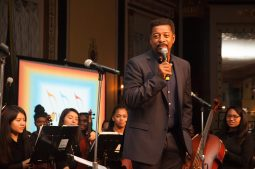 Charles Brown takes the mic during a performance. | SHANEL ROMAIN/Contributor