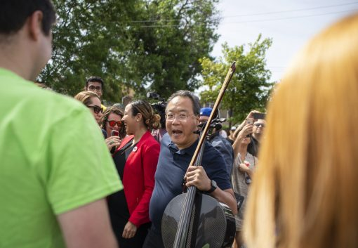 Cellist Yo-Yo Ma walks through the crowd on Friday, June 21, during the Yo-Yo Ma's Day of Action at Unity Park in Chicago's Homan Square neighborhood. | ALEXA ROGALS/Staff Photographer