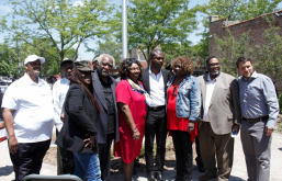 GRAND OPENING: Local politicians stand for a photo on June 14 in Austin's new 29th Ward Veterans Peace Garden. | MAIA McDONALD/Contributor