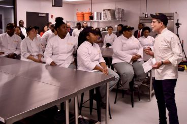 BASIC TRAINING: Celebrity Chef Rick Bayless, right, with participants in the inaugural cohort of his Impact Culinary Training, an eight-week professional instruction program for young adults on the West Side. The program takes place at the Hatchery in East Garfield Park. | Submitted photo
