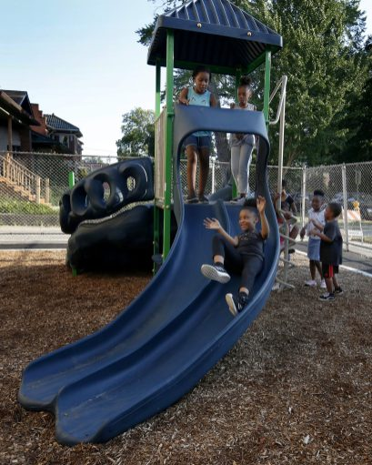 Students try out the new playground equipment St. Catherine St. Lucy School, 27 Washington Blvd in Oak Park, following a ribbon cutting ceremony on Aug. 7. The school received a donation from Enchanted Backpack and Big Shoulders to complete the first playground in the school's history. | Archdiocese of Chicago