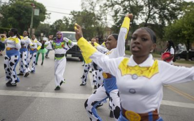 A group of dancers perform on Saturday, Aug. 17, during the 40th annual Danny Davis Back to School Parade along Central Avenue in Austin. | ALEXA ROGALS/Staff Photographer