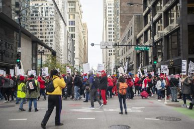 Demonstrators march down Dearborn Street on Thursday, Oct. 17, during a Chicago Teachers Union rally in the Chicago Loop. | ALEX ROGALS/Staff Photographer