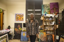 Opening up: Instructor Levette Haynes, of Chicago, stands in a room surrounded by artwork on Nov. 15, during an open art theater for the West Side Cultural Arts Council at the Garfield Park Gold Dome in Weat Garflield Park. | ALEX ROGALS/Staff Photographer
