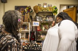 Instructor Levette Haynes, left, and Lorriell Lockhart, check out the students artwork. | ALEX ROGALS/Staff Photographer