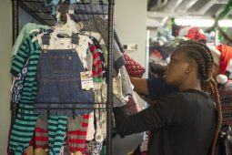 Parents shop for clothing for their children on Dec. 16, during a toy drive and holiday party at New Moms in Chicago's Austin neighborhood. | ALEX ROGALS/Staff Photographer
