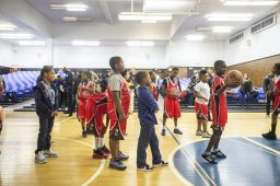 Players line up to practice free throws on Dec. 19, during youth basketball training from the Chicago Westside Police at Genevieve Melody Public School in Chicago. | ALEX ROGALS/Staff Photographer