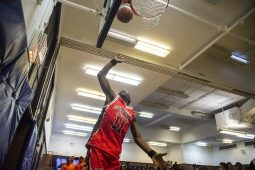 Players practice their jump shots on Dec. 19, during youth basketball training from the Chicago Westside Police at Genevieve Melody Public School in Chicago. | ALEX ROGALS/Staff Photographer