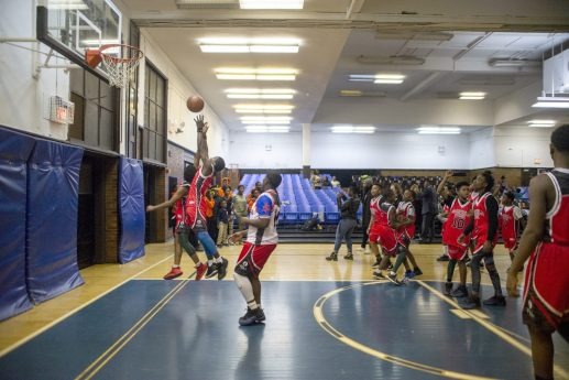 Players scrimmage each other on Dec. 19, during youth basketball training from the Chicago Westside Police at Genevieve Melody Public School in Chicago. | ALEX ROGALS/Staff Photographer