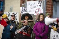 Demonstrators chant on Jan. 12, during a Mute R. Kelly protest outside of his studio on Justine Street in Chicago. | Photo by ALEX ROGALS/Staff Photographer