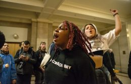 An activist with No Cop Academy protests at City Hall on March 13 against a proposed 5 million police and fire training academy in West Garfield Park. | Photo by ALEX ROGALS/Staff Photographer