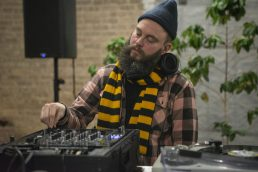 Live DJ's play music for attendees at new roastery for Passion House Coffee and Roasters in East Garfield Park. | ALEX ROGALS/Staff Photographer