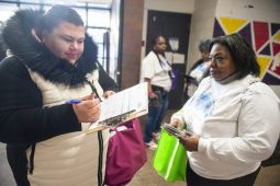 Autumn Williams, left, of Chicago, fills out a census information form with volunteer Pam Sanders, of Chicago.   ALEX ROGALS/Staff Photographer