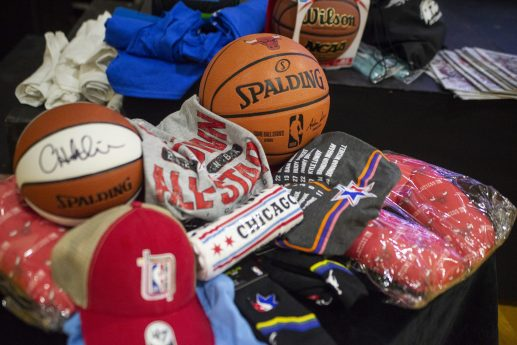 Different sports and basketball raffle prizes are seen for the kids on Feb. 15, during an NBA All-Star viewing party and Census Jumpoff at Collins Academy High School in Chicago. | ALEX ROGALS/Staff Photographer