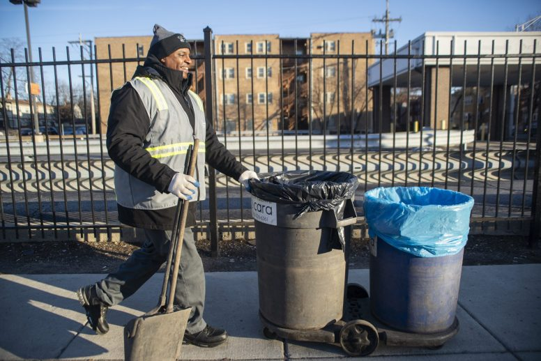 Crew member Lawerence Johnson begins cleaning up the sidewalks on Roosevelt Road near the corner of Austin Boulevard in Oak Park. | ALEX ROGALS/Staff Photographer