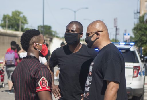 LaShawn Ford talks with a group on Saturday, July 25, 2020, during the Love March along Cocoran Street in Chicago's Austin neighborhood. | ALEX ROGALS/Staff Photographer