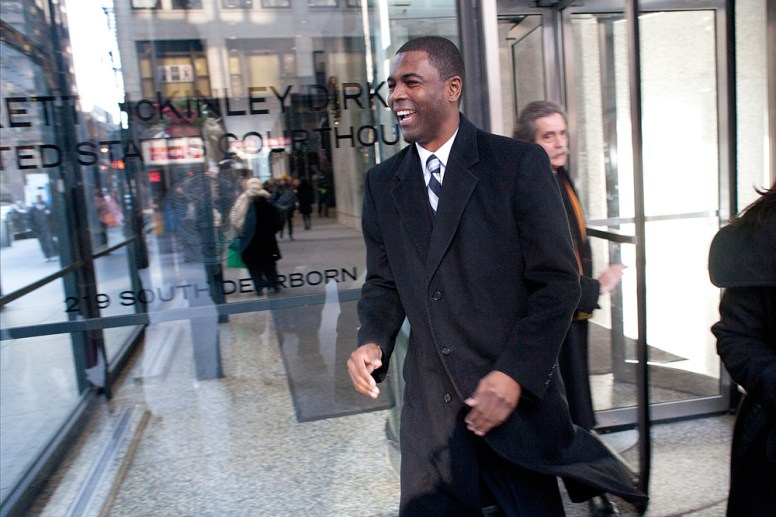 Fired up: LaShawn Ford, uplifted by supporters, smiled as he left federal court in Chicago following his arraignment on Tuesday.