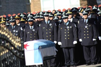 Chicago Police stand in respect by Off. Lewis' casket outside United Baptist Church during his funeral on Jan. 5, 2012.