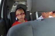 Nariah and her brother Nolan argue over who sits where during the 15-minute ride to school.