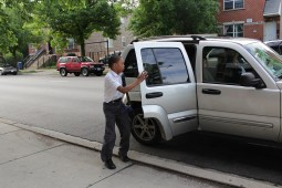 Nolan, a third-grader at St. Malachy School on the West Side, shuts the car door upon his arrival to school.