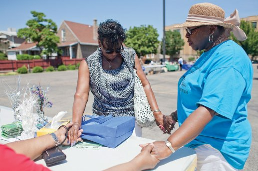 Ocie McCall, center, stopped by a prayer table and joined a circle with Lalita Pittman, right, and Carolyn Davidson.