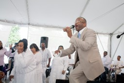 With the service ended, a group returns to the tent after singing and praising starts back up.