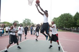 Young men play basketball during National Night Out in Moore Park. (David Pierini/staff photographer)