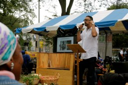 """John Owens speaks at the """"Green Pavilion"""" about rejuvinating the culture of Bronzeville and making a greener South Side. (ASHLEY LISENBY/digital editor)"""