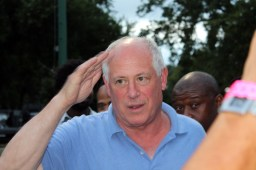 Governor Pat Quinn salutes a crowd of festival organizers; distiguished guests and photographers. (ASHLEY LISENBY/digital editor)