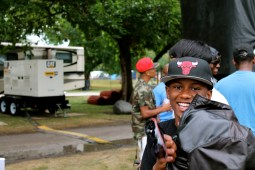 """Tre Tre,12, a young rapper smiles after he finishes performing a remixed version of """"Jump"""" originally by Kriss Kross. (ASHLEY LISENBY/digital editor)"""