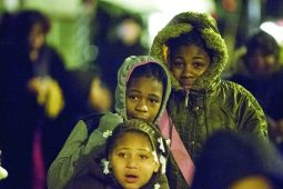 Lamyha Swanigan, Christa Brown and Diamond Brown braved the cold as the parade approached. (DAVID PIERINI/Staff Photographer)