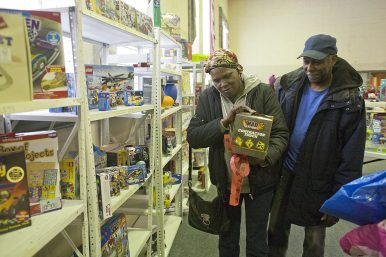 Good deeds and deals: Laris Wells and her husband, Vernon, shop for toys at the Bethel New Life Christmas Store Dec. 14. (DAVID PIERINI/Staff Photographer)