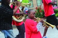 Tremell Neloms from Diamond in the Rough playing during the Juneteenth Parade and Festival along Chicago Avenue June 15. (DAVID PIERINI/Staff Photographer)