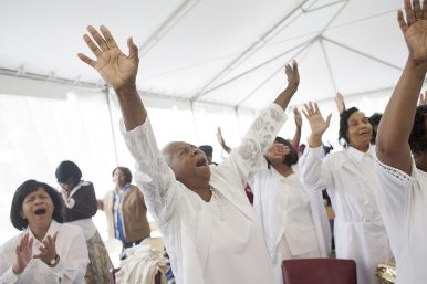 "Mother Lula Robertson sings ""Praise for Me"" with the rest of the congregation at Inspirational Deliverance Center Church of God in Christ's tent revival in July. (DAVID PIERINI/Staff Photographer)"