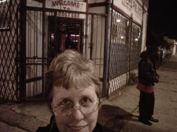 Blogger in front of former Roosters Palace at Madison & Kilbourn