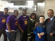 Reverend Jones with Paxton Ferencak and members of the West Garfield Park Youth Council