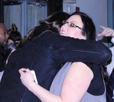 Dawn Ferencak, Sales Representative for Austin Weekly News, is congratulated after her promotion to Associate Publisher was announced.