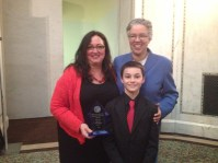 Dawn Ferencak, Associate Publisher of Austin Weekly News, with son Paxton and Toni Preckwinkle, Cook County Board President