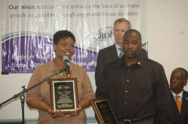 Tarcia Patton and Jermaine Cullum, Sr. thank Gift of Hope June 25 for honoring them with an award for donating their late son's organs for medical research. Since Jermaine Cullum Jr.'s death May 6, the agency has seen an increase in organ donor interest. Photos by Michael Romain
