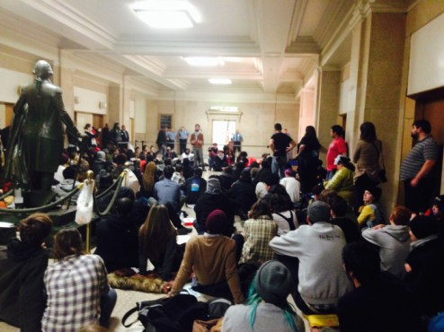 Demonstrators camped outside Mayor Rahm Emanuel's office in City Hall Nov. 25, to protest urban violence and racial discrimination following the grand jury announcement in Ferguson Missouri the night before. The Chicago Teachers' Union sent over pizzas to the demonstrators. (Megan K. Rauch/MEDILL)