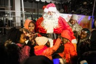 Santa Claus visits with children during the Austin Chamber of Commerce's 10th Annual Tree Lighting and Holiday Party, outside the 15th District Police Station, 5701 W. Madison, on Thursday, December 4, 2014. | Chandler West/Staff Photographer