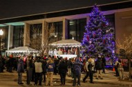 A crowd gathers outside the 15th District Police Station, 5701 W. Madison, to watch the Austin Chamber of Commerce's 10th Annual Tree Lighting on Thursday, December 4, 2014. | Chandler West/Staff Photographer