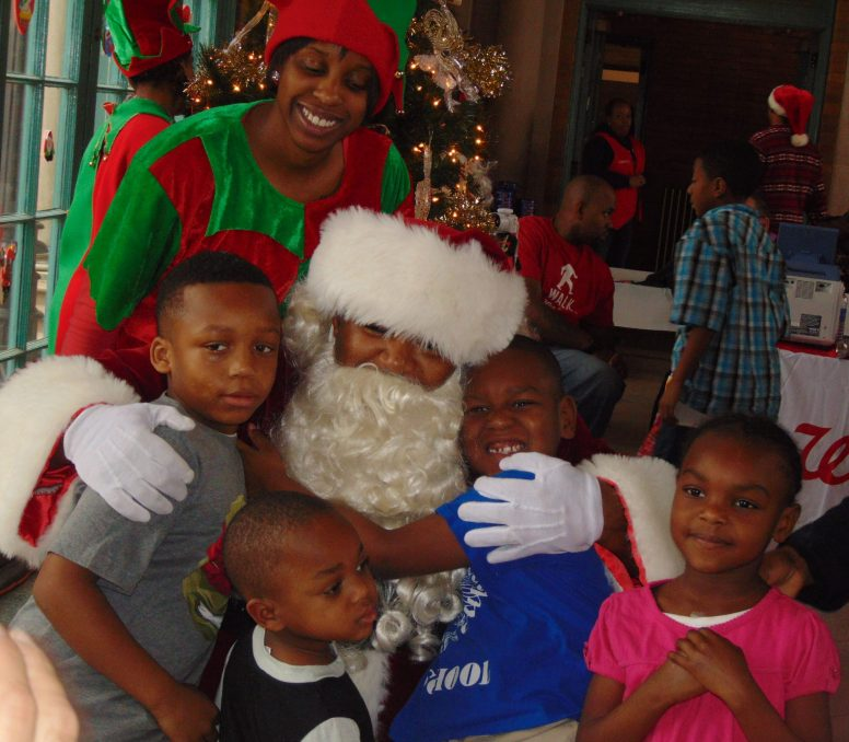 Santa and his elf pose with siblings Marieon, Daniel, Imond and Danielle, who came with their mom, Carolyn Section.